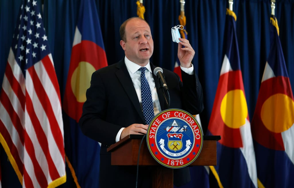 Colorado governor stands firm against issuing statewide mask mandate
