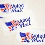 """Colorado secretary of state sues Postal Service over """"misinformation"""" about voting."""